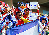 A Costa Rica supporter holds a sign saying 'Good bye England' after his sides 1-0 victory over Italy eliminated England from the World Cup
