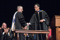 Interim Vice President for Academic Affairs and Dean of the College Kerry Thompson presents geology professor Scott Bogue with the Graham L. Sterling Memorial Award. 508 members of the Class of 2020 are welcomed to Occidental College by trustees, faculty and staff in Thorne Hall on Aug. 30, 2016 during Oxy's 129th Convocation ceremony, a tradition that formally marks the start of the academic year and welcomes the new class.<br /> (Photo by Marc Campos, Occidental College Photographer)