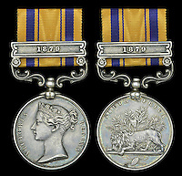 BNPS.co.uk (01202 558833)<br /> Pic: DixNoonanWebb/BNPS<br /> <br /> Charles Robson's Zulu war medal.<br /> <br /> A medal awarded to one of the defenders of Rorke's Drift, which was immortalised in the film Zulu, has sold for &pound;132,000 138 years on.<br /> <br /> Driver Charles Robson was the batman, or personal servant, to Victoria Cross hero Lieutenant John Chard, who was played by Stanley Baker in the classic 1964 movie.<br /> <br /> The duo formed part of the 140-strong British garrison which defied all odds to successfully defend the Rorke's Drift mission station from 4,000 marauding Zulu warriors in 1879.<br /> <br /> Robson never left the side of Lt Chard, who was the commanding officer and who organised the epic defences which included piling up mealie bags to form a makeshift wall.<br /> <br /> The medal went under the hammer with London auctioneers Dix Noonan Webb today and went for a record &pound;132,000.
