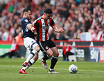 Enda Stevens of Sheffield Utd  tackled by Lee Gregory of Millwall during the championship match at the Bramall Lane Stadium, Sheffield. Picture date 14th April 2018. Picture credit should read: Simon Bellis/Sportimage