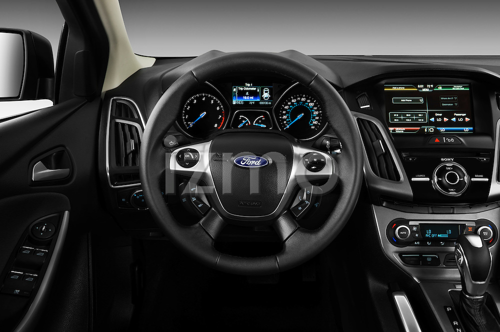 steering wheel view of a 2012 ford focus hatchback titanium stock photo