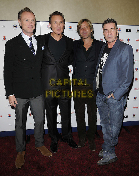 "Spandau Ballet -  Gary Kemp, Martin Kemp, Steve Norman & John Keeble.attended the ""Stalker"" UK film premiere, Empire cinema, Leicester Square, London, England, 15th October 2011..full length back band group suit jacket tie white shirt blue grey gray trousers .CAP/CAN.©Can Nguyen/Capital Pictures."