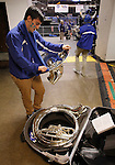 SIOUX FALLS, SD - MARCH 10:  Eric Ewald of the IPFW pep band polishes his sousaphone before their game against Western Illinois in women's basketball during the 2013 Summit League Basketball Championships Sunday at the Sioux Falls Arena. (Photo by Dick Carlson/Inertia)