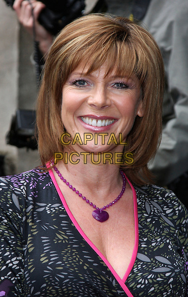 RUTH LANGSFORD.The Television and Radio Industries Club (TRIC) Awards at the Grosvenor House Hotel, Park Lane, London, England, UK, March 10th, 2009..headshot portrait grey gray black purple trim necklace fringe lola rose heart stone smiling .CAP/CAN.©Can Nguyen/Capital Pictures