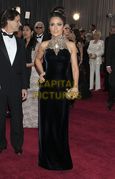 Salma Hayek (wearing McQueen).85th Annual Academy Awards held at the Dolby Theatre at Hollywood & Highland Center, Hollywood, California, USA..February 24th, 2013.oscars full length black dress clutch bag gold embellished jewel encrusted high collar sleeveless hand on hip.CAP/ADM/RE.©Russ Elliot/AdMedia/Capital Pictures.