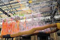 """ATENCAO EDITOR:FOTO EMBARGADA PARA VEICULOS INTERNACIONAIS-RIO DE JANEIRO, RJ, 11 SETEMBRO 2012 - ARTE-BICHO SUSPENSO NA PAISAGEM- A centenaria Estacao Leopoldina (Av. Francisco Bicalho, S/N) recebe a obra """"O Bicho Suspenso na Paisagem""""  de Ernesto Neto. Trata-se de uma especie de tunel feito de cordas de polietileno em cinza, verde, rosa e amarelo, costuradas em croche, suspenso no teto. No piso do tunel, bolas de plastico cinza, como pedras, para os visitantes entrarem. De quarta a sexta, das 10h as 19h, sabados de 10h as 20h e domingos de 10h as 17h, na Leopoldina, zona Portuaria do Rio de Janeiro. FOTO: MARCELO FONSECA / BRAZIL PHOTO PRESS"""