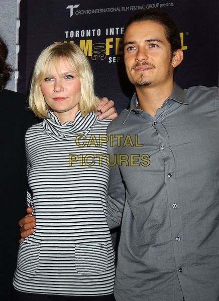 "KIRSTEN DUNST & ORLANDO BLOOM.For ""Elizabethtown"". The 2005 Toronto Film Festival press conferences held at Sutton Place Hotel, Toronto, Canada..September 11tth, 2005.Photo Credit: Laura Farr/Admedia.half length mustache goatee facial hair black white striped top grey gray shirt.www.capitalpictures.com.sales@capitalpictures.com.© Capital Pictures."