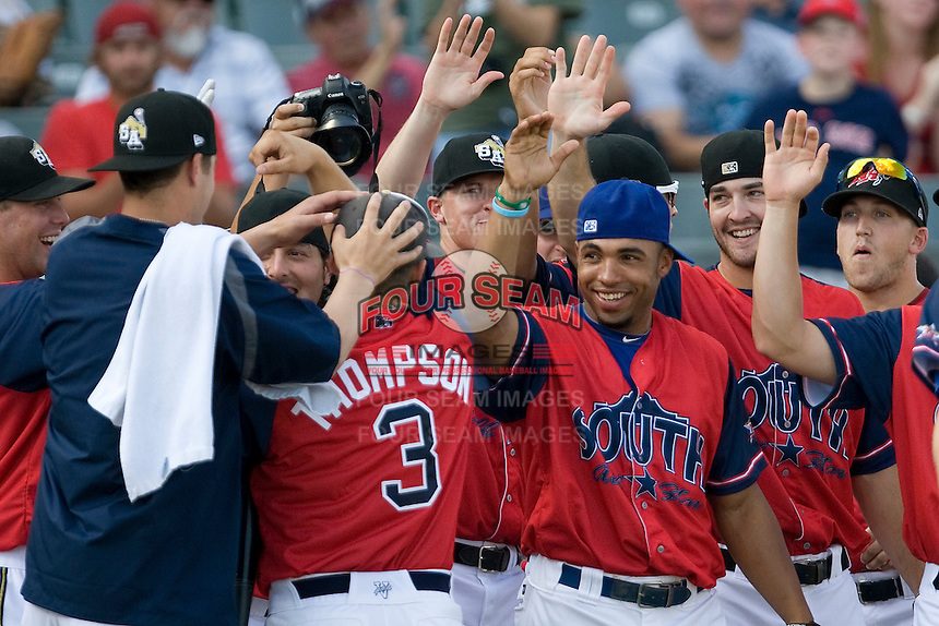 San Antonio high schooler Landon Thompson is greeted by his South All Star teammates at the home run derby before the Texas League All Star Game played on June 29, 2011 at Nelson Wolff Stadium in San Antonio, Texas. Using a aluminum bat, Thompson won the contest competing against professional baseball players. (Andrew Woolley / Four Seam Images)