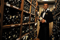 A waiter in the large wine cellar of the exclusive Apicius French restaurant in the  Ginza area of Central Tokyo, 17th September, 2008.<br />