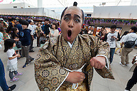 An actor dressed as a a samurai from the Edo (samurai) Period joking pulls a face to welcome visitors to Haneda International Airport, Tokyo, Japan. Tuesday May 3rd 2016. The Edo festival takes place over the three days of national holidays called Golden Week ( May 3rd to 5th) and features costume parades, music and stage shows along with other fun activities for visitors in and around the Edo themed shopping areas in the terminal building.