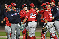 Pitcher Trevor Bettencourt (25) of the Lakewood BlueClaws is congratulated by teammates after combining with Nick Fanti to throw a no-hitter against the Columbia Fireflies on Saturday, May 6, 2017, at Spirit Communications Park in Columbia, South Carolina. Fanti pitched a scoreless 8 and two-thirds, with Bettencourt picking up the final out for a 1-0 win. (Tom Priddy/Four Seam Images)