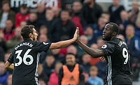 Matteo Darmian of Man Utd congratulates goal scorer Romelu Lukaku of Man Utd during the Premier League match between Stoke City and Manchester United at the Britannia Stadium, Stoke-on-Trent, England on 9 September 2017. Photo by Andy Rowland.