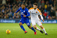 Junior Hoilett of Cardiff City gets past Jon Toral of Hull City during the Sky Bet Championship match between Cardiff City and Hull City at the Cardiff City Stadium, Cardiff, Wales on 16 December 2017. Photo by Mark  Hawkins / PRiME Media Images.