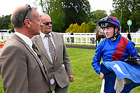 Jockey William Carson talks to connections of Cotton Club in the winers enclosure during Afternoon Racing at Salisbury Racecourse on 13th June 2017