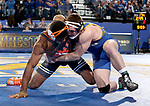 BROOKINGS, SD - NOVEMBER 17: Brett Bye from South Dakota State University battles with Jacobe Smith from Oklahoma State University during their 174 pound match Saturday night at Frost Arena in Brookings. (Photo by Dave Eggen/Inertia)
