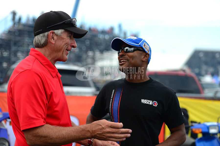 Sept. 28, 2012; Madison, IL, USA: NHRA top fuel dragster driver Antron Brown (right) talks with Mike Lewis during qualifying for the Midwest Nationals at Gateway Motorsports Park. Mandatory Credit: Mark J. Rebilas-