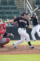Michael Danner (2) of the Kannapolis Intimidators follows through on his swing against the Hagerstown Suns at CMC-Northeast Stadium on July 19, 2015 in Kannapolis, North Carolina.  The Suns defeated the Intimidators 9-4.  (Brian Westerholt/Four Seam Images)
