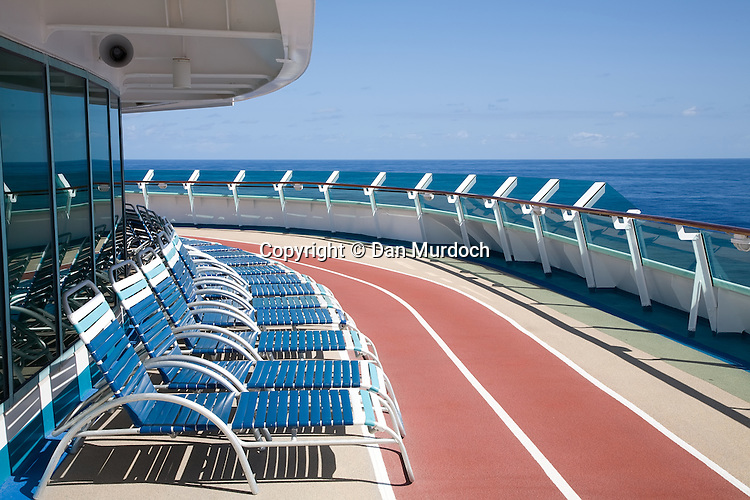 "The Royal Caribbean cruise ship ""Explorer of the Seas"" at sea, deck chairs waiting."