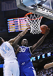 North Carolina Tar Heels forward Desmond Hubert (14) attempts to block Kentucky Wildcats forward Julius Randle (30) from shooting a layup during the UK men's basketball vs. North Carolina at the Dean Smith Center in Chapel Hill, N.C., on Saturday, December 14, 2013. Photo by Emily Wuetcher   Staff