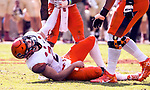 Teammates help up a battered Syracuse quarterback Eric Dungey after a hit in the second half of an NCAA college football game against Florida State in Tallahassee, Fla., Saturday, Nov. 4, 2017. Florida State defeated Syracuse 27-24. (AP Photo/Mark Wallheiser)