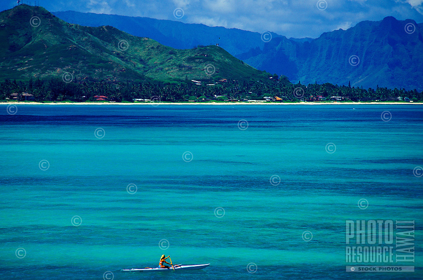 Single kayak out in the blue waters of Kailua bay, on the windward side of the island of Oahu