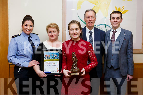 Miriam Hanlon from Asdee who received a Special Distinction award at the Kerry Garda Lee Strand Youth Achievements Awards held in the Ballyroe Heights Hotel on Friday night last. L-r, Garda Sarah Jennings, Mairead, Miriam, Tony and Anthony Hanlon.
