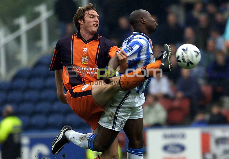 COPYRIGHT PICTURE SIMON WILKINSON  01943 436649  .29/04/00 NATIONWIDE LEAGUE DIVISION ONE.HUDERFIELD V STOCKPORT COUNTY:- Huddersfield's Clyde Wijnhard and Stockport's Martin Taylor.