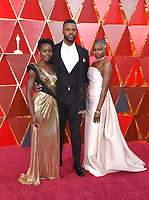 Lupita Nyong'o, from left, Winston Duke, and Danai Gurira arrive at the Oscars on Sunday, March 4, 2018, at the Dolby Theatre in Los Angeles. (Photo by Richard Shotwell/Invision/AP)