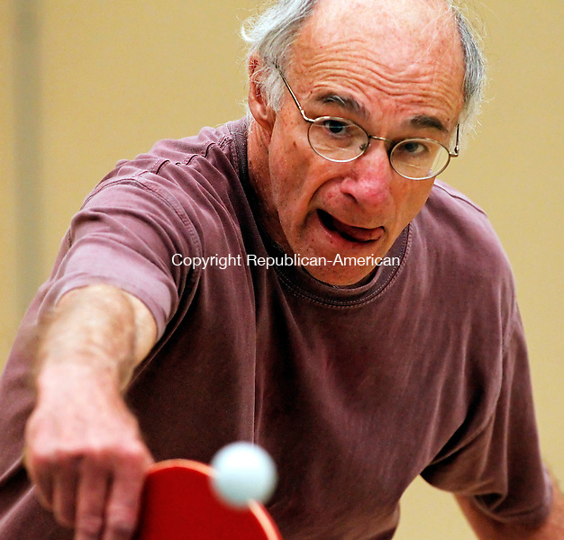 Woodbury, CT-10, May 2010-051010CM02 Barry Wolf of Southbury, sends a shot back to Bob Schepis of Naugatuck, during their match inside the Woodbury Senior Center Monday morning.  Wolf won the match 21-19.  Along with friend, Richard Johnson, of Southbury the trio were enjoying several games of pingpong.    --Christopher Massa Republican-American