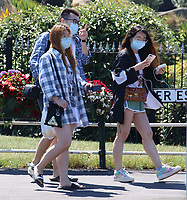 People wear face masks in the heatwave<br /> People head to the beach at the popular seaside resort of Skegness as England has it's hottest day of the year with temperatures well into the 30 degrees celcius. Kegness, England, UK on June 25, 2020.<br /> CAP/ROS<br /> ©ROS/Capital Pictures