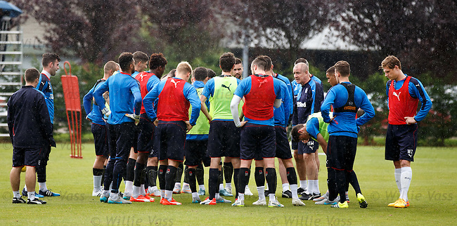 Mark Warburton stops training and gathers his players around for a discussion