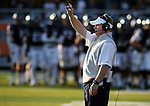 Nevada Head Coach Brian Polian works the sidelines of his first home game in Reno, Nev., on Saturday, Sept. 7, 2013. (AP Photo/Cathleen Allison)