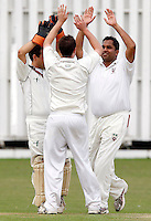 A Scrini (L) and Chetan Patel (R) high five M Tucker after he dismissed D Hawes of Bessborough during the Middlesex County Cricket League Division Three game between Hornsey and Bessborough at Tivoli Road, Crouch End on Sat Aug 21, 2010.