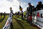 Darlington fans with flags and the Quaker mascot, wait to welcome the teams. Darlington 1883 v Southport, National League North, 16th February 2019. The reborn Darlington 1883 share a ground with the town's Rugby Union club. <br /> After several years of relegations, bankruptcies, and ground moves, the club is fan owned, and back on an even keel in the National League North.<br /> A 0-0 draw with Southport was marred by a broken leg and dislocated knee suffered by Sam Muggleton, Darlington's on loan left back.<br /> Both teams finished the season in lower mid table.