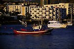 Fishing boat leaving the harbour of San Juan,Tenerife, Canary Islands, Spain