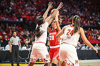 College Park, MD - March 23, 2019: Radford Highlanders forward Lydia Rivers (20) tries to shoot over Maryland Terrapins guard Kaila Charles (5) during game between Radford and Maryland at  Xfinity Center in College Park, MD.  (Photo by Elliott Brown/Media Images International)