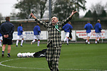 Burscough 3, Gillingham 2, 05/11/2005. Victoria Park, Burscough, FA Cup first round. An entertainer on the pitch before the match. The team from the Northern Premier League Premier Division defeated their Football League Championship rivals by 3-2 with two goals in the last minute, watched by a crowd of 1927 spectators. Photo by Colin McPherson.