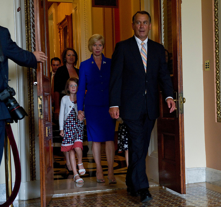 WASHINGTON, DC - July 19: House Speaker John A. Boehner, R-Ohio, leads newly sworn-in Rep. Janice Hahn, D-Calif., in blue, and her family into a room at the U.S. Capitol for a mock swearing in for the media. She holds hands with granddaughters McKenna, 8, and Brooklyn, 6. (Photo by Scott J. Ferrell/Congressional Quarterly)