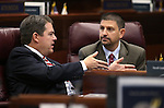 Nevada Sens. Michael Roberson, R-Las Vegas, left, and Mark Manendo, D-Las Vegas, work in a special session at the Nevada Legislature, in Carson City, Nev., on Wednesday, Sept. 10, 2014. Lawmakers are considering a complex package of up to $1.3 billion in tax breaks and other incentives as part of a deal to bring Tesla Motors to Nevada. (AP Photo/Cathleen Allison)