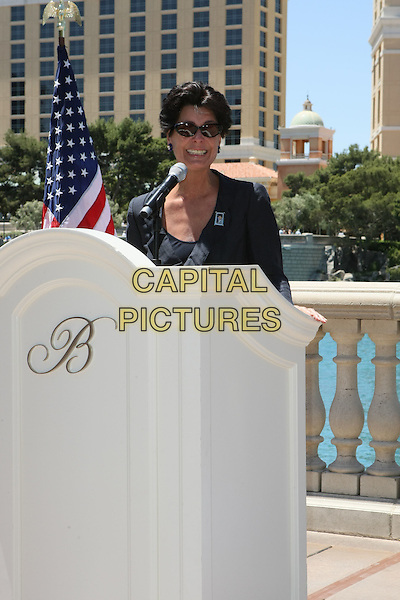 TINA SINATRA.The Unveiling of the Frank Sinatra Stamp held at the Bellagio Hotel Resort, Las Vegas, Nevada, USA..May 13th, 2008.half length black blue suit jacket sunglasses shades podium microphone .ADM/MJT.© MJT/AdMedia/Capital Pictures.