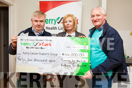 Breda and Dermot Lynch gives a donation of €44,000 from the Glenflesk Running Group who raised funds in honour of her 18-year old daughter Leah who was diagnosed with cancer and the money is been presented for the Kerry Cork Health Link Bus. L-r, Dan Horan, Breda and Dermot Lynch.