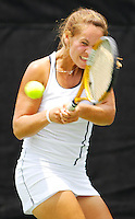 Florida International University sophomore Egle Petrauskaite returns a shot during her match against Iowa's Hillary Mintz in the first round of the 2006 NCAA Coral Gables Regionals at the Neil Schiff Tennis Center on Friday, May 12, 2006.  Petrauskaite defeated Mintz in straight sets, 7-5, 6-1, to help the Golden Panthers defeat the Hawkeyes, 4-1, and advance to  a second round meeting with the University of Miami.