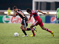 Chris Pontius (13) of D.C. United sprints past Pavel Pardo (17) of the Chicago Fire at RFK Stadium in Washington, DC.  D.C. United defeated the Chicago Fire, 4-2.