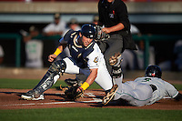 Burlington Bees catcher Wade Wass (44) swipes the tag as Brock Hebert (3) slides into home during a game against the Clinton LumberKings on August 20, 2015 at Community Field in Burlington, Iowa.  Burlington defeated Clinton 3-2.  (Mike Janes/Four Seam Images)