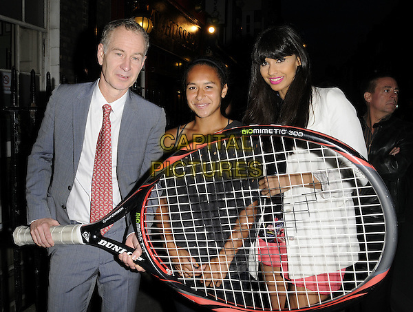 John McEnroe, Heather Watson & Jameela Jamil .At the Slazenger Party, The House of St. Barnabas, Greek Street, London, England, UK, 23rd June 2011..half length giant tennis racquet oversized  white blazer jacket grey gray suit red tie white shirt .CAP/CAN.©Can Nguyen/Capital Pictures.