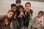 Afghan children eating ice cream, Kabul, Afghanistan