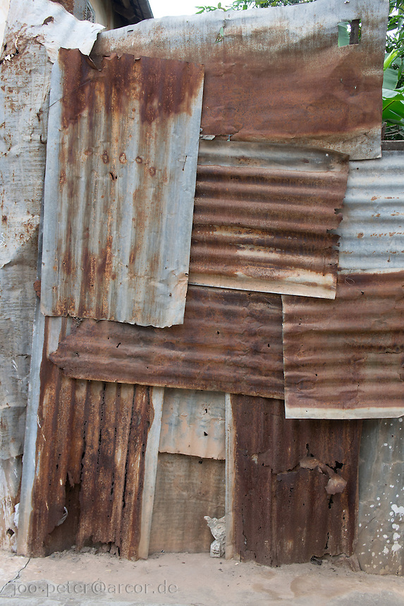 patchwork metal wall (corrugated iron) rusty and  withering in capitol Vietiane, Laos, 2012