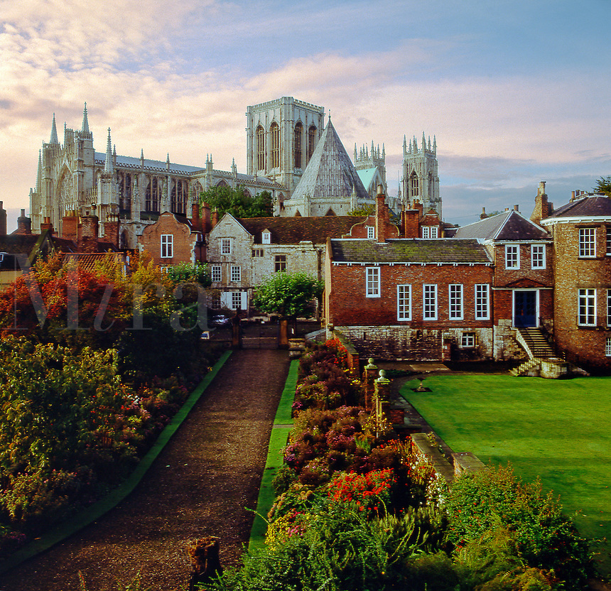 York Minster and the Treasurer's House seen from the city wall. 12th to 15th  Centuries. Evening.  Yorkshire. England..