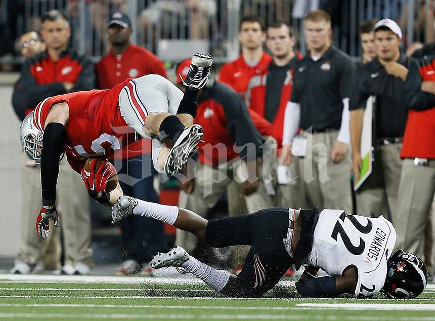 Ohio State Buckeyes tight end Jeff Heuerman (5) gets flipped by Cincinnati Bearcats safety Zach Edwards (22) in the third quarter of the college football game between the Ohio State Buckeyes and the Cincinnati Bearcats at Ohio Stadium in Columbus, Saturday afternoon, September 27, 2014. The Ohio State Buckeyes defeated the Cincinnati Bearcats 50 - 28. (The Columbus Dispatch / Eamon Queeney)