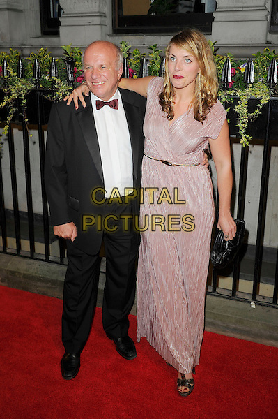 Greg Dyke &amp; guest<br /> attending the BFI Luminous Gala Dinner, 8 Northumberland Avenue, London, England. <br /> 8th October 2013<br /> full length black tuxedo white shirt pink dress <br /> CAP/MAR<br /> &copy; Martin Harris/Capital Pictures